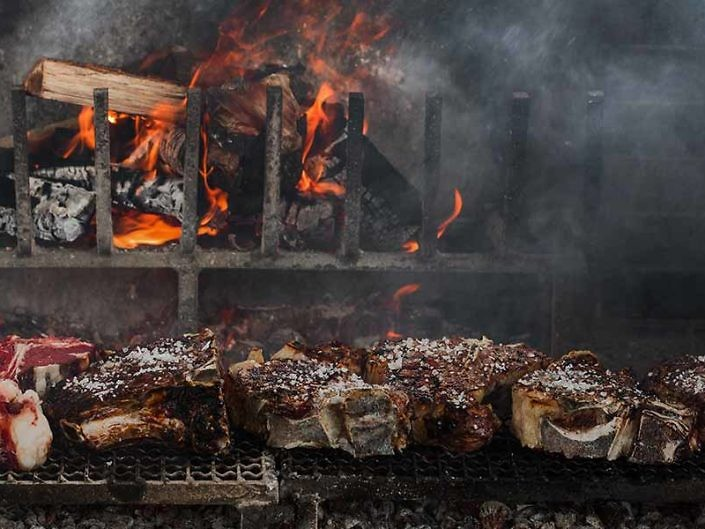 "Meat & Fire <p style=""white; font-size:14px; text-transform:none"">Dive into the scenery of Castilian Spain and the greatest grilled meats in the world.</p>"