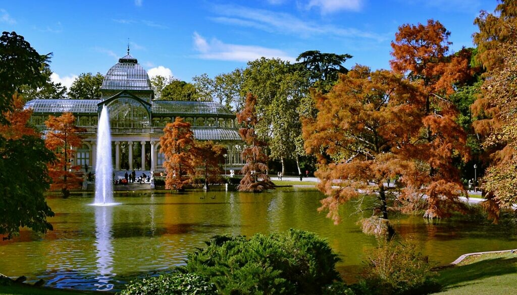 The Retiro Park in Madrid in Spain in autumn and the lake